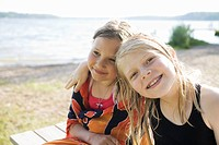 Two girls on a beach, Sweden.