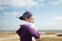 Woman after exercise at beach with towel