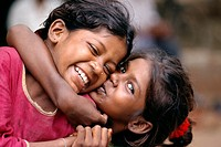 Portrait of two Indian girls hugging, New Delhi, India