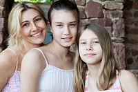 Mother and daughters to camera