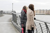 2 young women looking at river