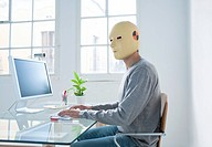 Man in crash test dummy mask in an office