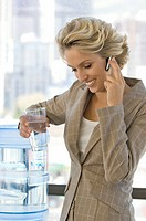 Buisness woman on the phone with water