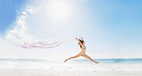 Woman running on beach with fabric