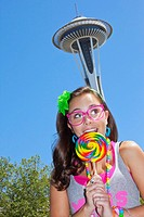 teen girl with lollipop and space needle