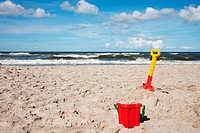 Children´s beach toys _ buckets, spade and shovel on sand