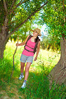 Beautiful young female hiker wearing backpack