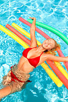 Young woman in swimwear having fun in swimming pool