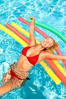 Young woman in swimwear having fun in swimming pool