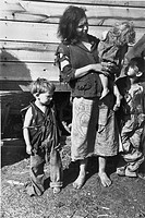 MIGRANT FAMILY, 1936.A mother and children at a migrant worker camp on U.S. 70 near the Tennessee River. Photographed in March 1936 by Carl Mydans.
