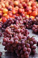 bunches of red grapes with nectarines in the background, calgary, alberta, canada