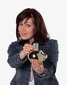 woman saving money in a piggy bank, edmonton, alberta, canada