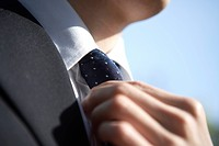 Businessman Adjusting Necktie