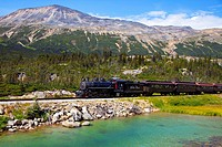 historic train travels through white pass trail, skagway, alaska, united states of america