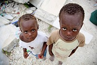 two children standing in earthquake ruins, port_au_prince, haiti