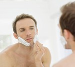 Man shaving, close up