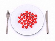 many hearts on the plate with knife and fork