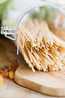 Pasta spilling from old fashion jar