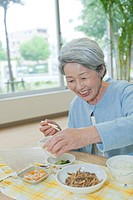 Senior Woman Eating in Nursing Home
