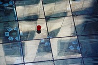 Red bucket on a glass roof