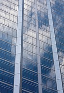 White clouds reflected in a glass skyscraper