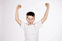 Preteen boy raising his arms