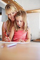 Woman watching her daughter draw