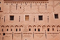 Photograph of a building made of mud and it´s unique decorations in the Moroccan city of Quarzazate