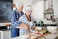 Senior couple making salad
