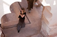 Photograph of a woman touring the mosque of Koutoubia in Marrakech , Morroco