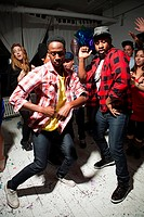 Men wearing checked shirts dancing at party