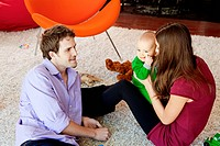 Parents with baby son in living room