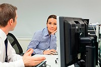 Businesswoman ignoring male colleague in office (thumbnail)