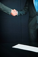 Two businessmen shaking hands at job interview