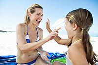 Mother playing with daughter 7_9 on beach towel