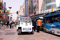 ELECTRIC POLICE CAR PATROLLING EAST NANJING ROAD, PUXI DISTRICT, SHANGHAI, PEOPLE'S REPUBLIC OF CHINA