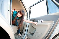 Girl opening car door (thumbnail)