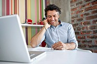 Smiling man working at desk