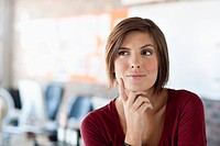 Portrait of pensive woman in office