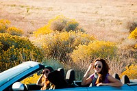 Three female friends in convertible car