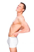 Junger Mann mit Rückenschmerzen