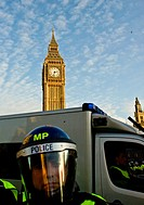 England, London, Westminster. Metropolitan riot police officer preparing for a student demonstration outside the Houses of Parliament.