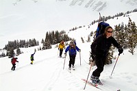 forty year old woman skis with a group in Banff National Park, Alberta, Canada
