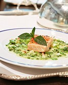 Salmon fillet on peas with fresh mint