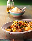 Tagliatelle with red lentils, vegetables and capers