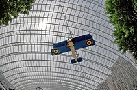 High-ceiling glass of garden with moving airplane in the of Kimmel Center, Philadelphia, Pennsylvania, PA, USA