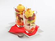 Two glasses of sundaes with fruit, close_up