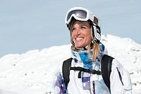 Austria, Kleinwalsertal, Young woman wearing ski goggles, smiling