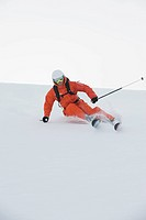 Austria, Kleinwalsertal, Man skiing, low angle view