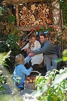 Austria, Salzburg, Flachau, Family in a farm garden